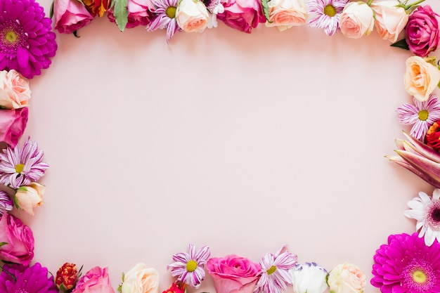 Colourful spring floral frame with copy space Free Photo