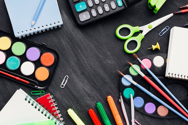 Colourful stationery for creating art and work on grey background Free Photo