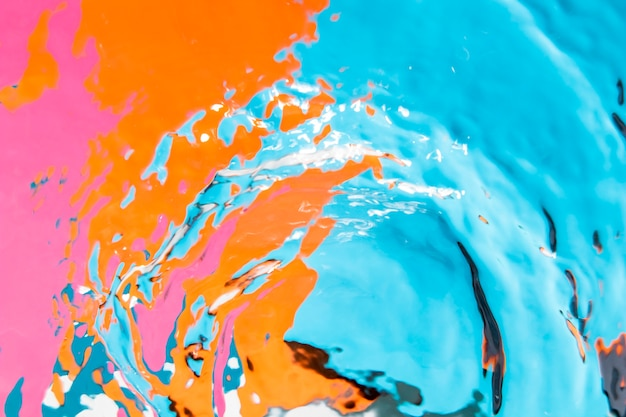 Colourful surface pool and crystalline water waves Premium Photo