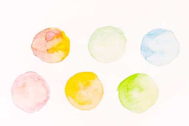 Colourful watercolour painted circles Free Photo