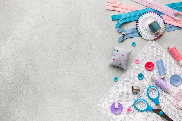 Colourful zippers and buttons with copy space background Free Photo