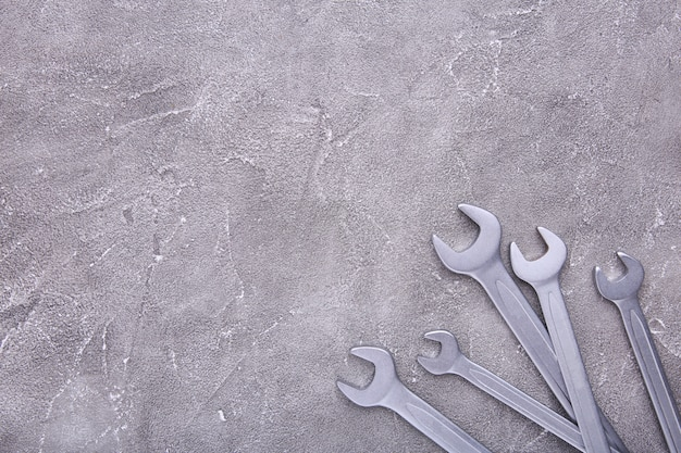 Combination wrenches for repair on grey concrete Premium Photo