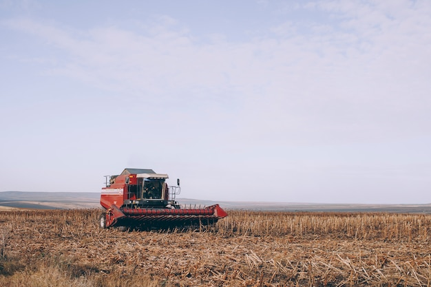A combine harvester is standing in a field close-up. Premium Photo