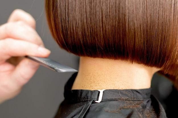 Combing hair of woman Premium Photo