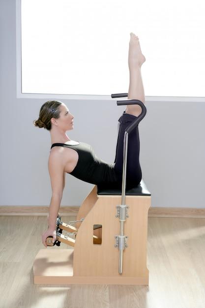 Combo wunda pilates chair woman fitness yoga gym Premium Photo