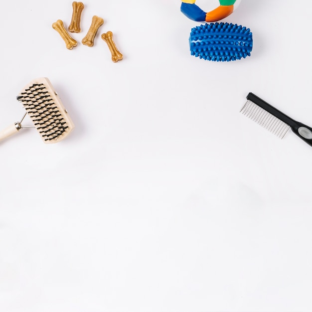 Combs near dog toys and dainties Free Photo