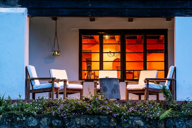 Comfortable chairs on the empty terrace in the evening, tanzania, east africa Premium Photo