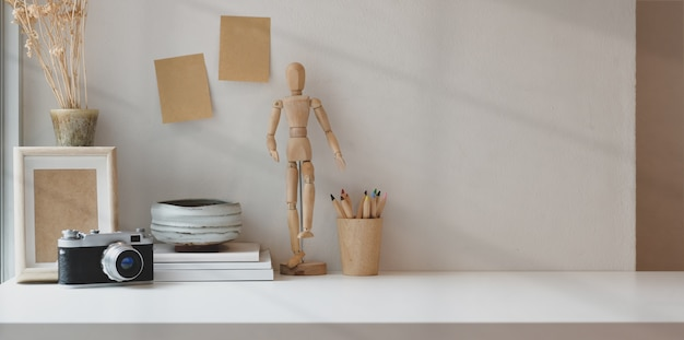 Comfortable workplace with copy space with photographer office supplies Premium Photo