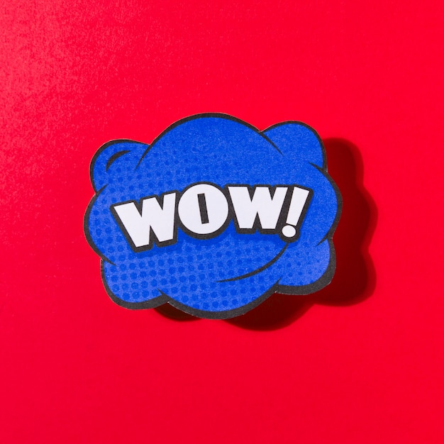 Comic lettering wow on red background Free Photo