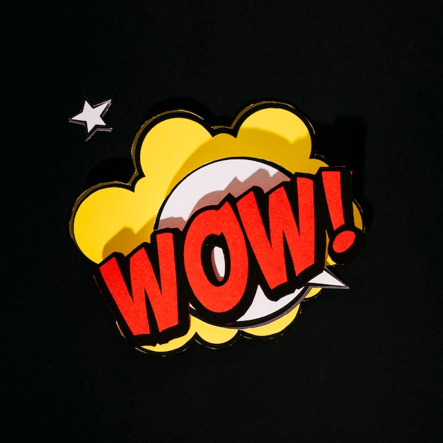 Comic wow! text sound effects speech bubble on black background Free Photo