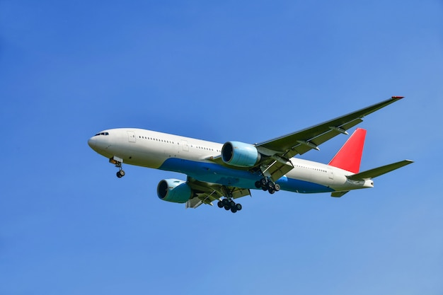 Commercial airplane flying in beautiful sky Premium Photo