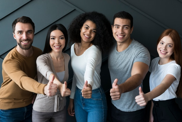 Community of positive young people smiling Premium Photo