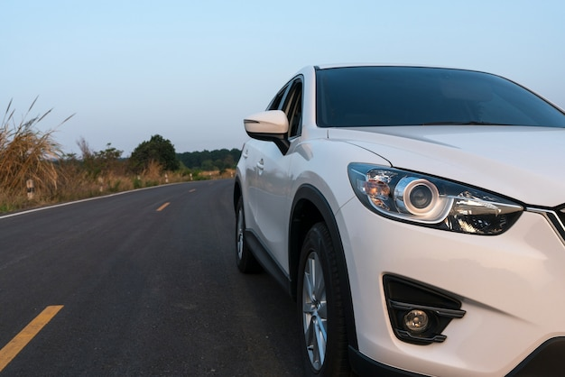 Compact suv car with sport and modern design parked on concrete road Premium Photo