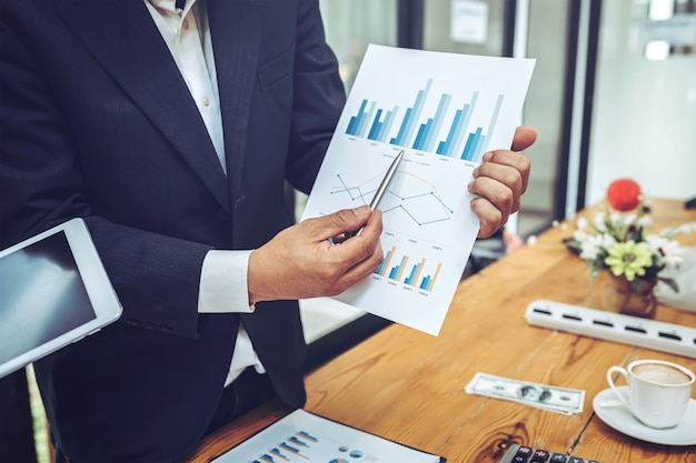 Company employees using tablet with business chart. Premium Photo