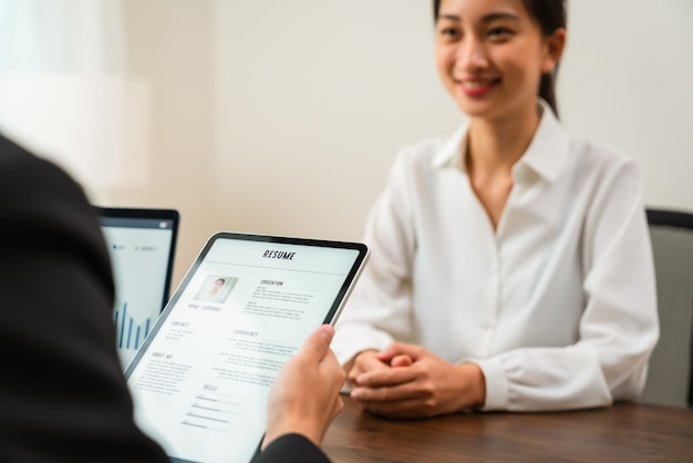 Company human resource (hr) is holding a resume application on tablet in hand. Premium Photo