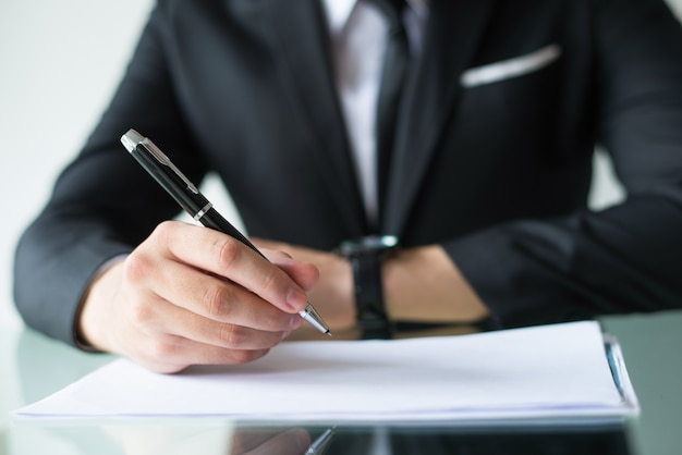 Company owner signing contract Free Photo