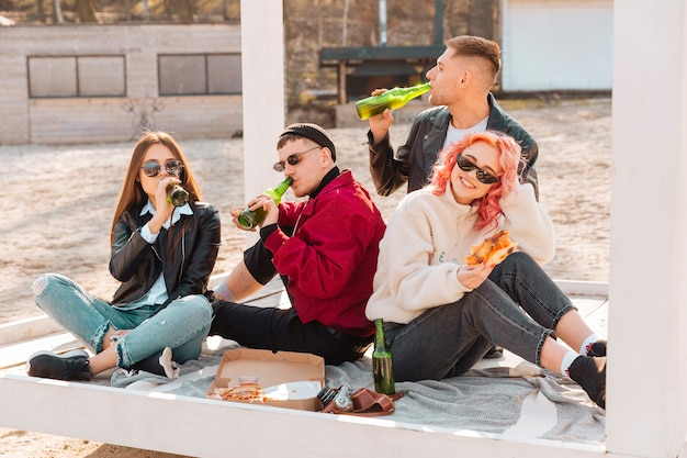 Company of smiling young friends on picnic Free Photo