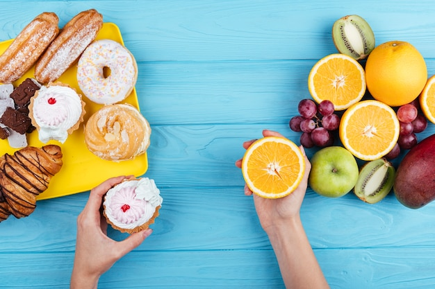 Comparison between sweets and fruit Free Photo