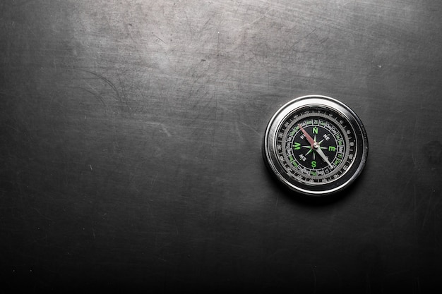 Compass on black board background Premium Photo