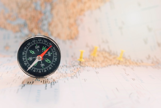 Compass on defocused map Free Photo