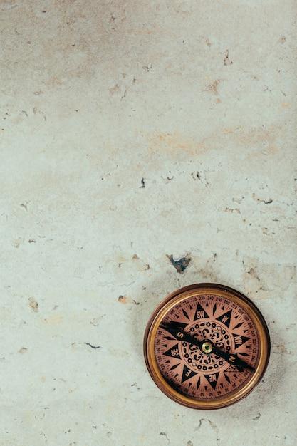Compass on a gray gradient background Premium Photo