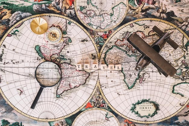 Compass and magnifying glass near writing Premium Photo