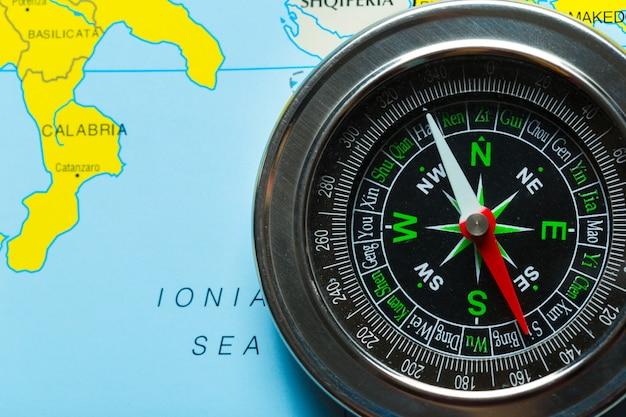 Compass on map background travel Premium Photo