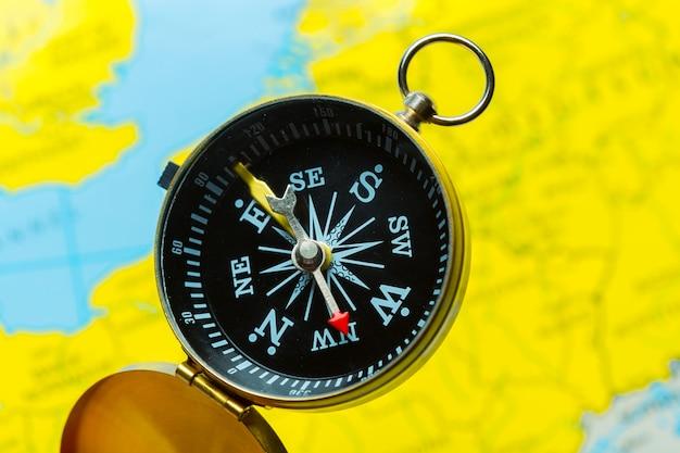 Compass on map  travel Premium Photo