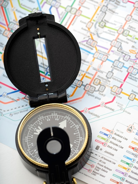 Compass on a map traveling in japan Premium Photo