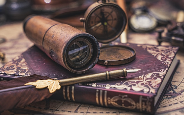 Compass and old collection on book Premium Photo
