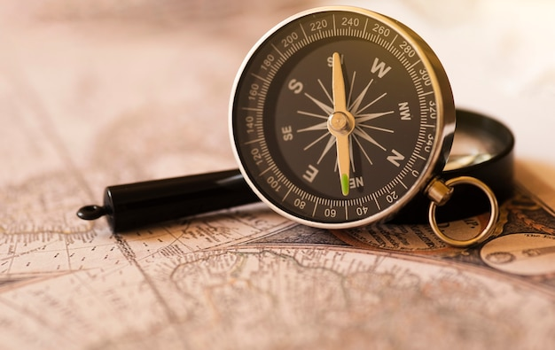 Compass on an old world map Free Photo