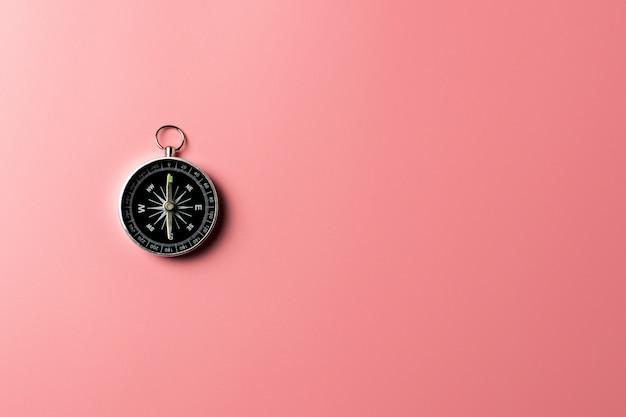 Compass on pink background. Premium Photo