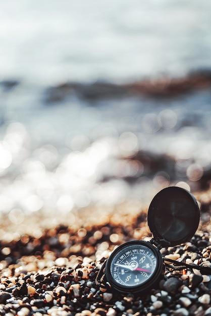 Compass on a sandy beach Premium Photo