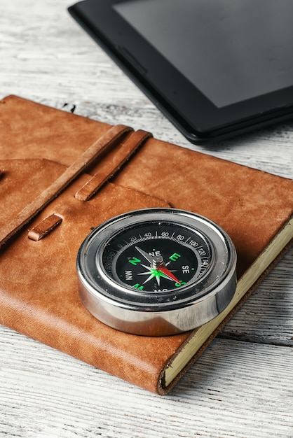 Compass and tablet Premium Photo