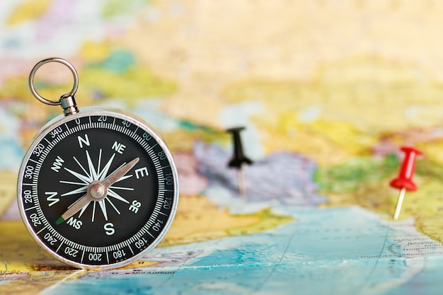 Compass on the tourist map Premium Photo