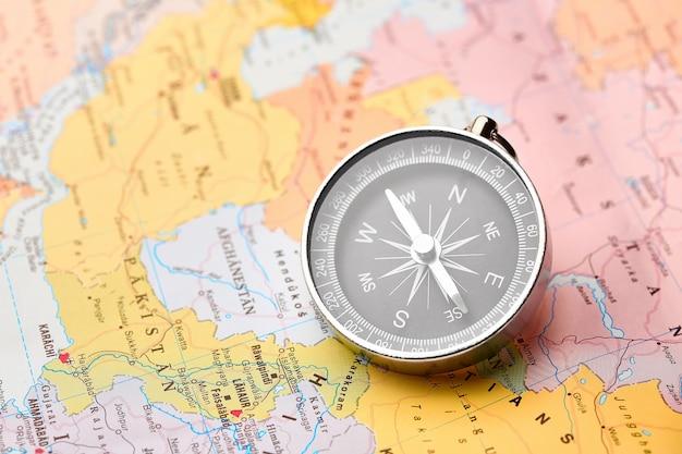 Compass on the tourist map Premium Photo