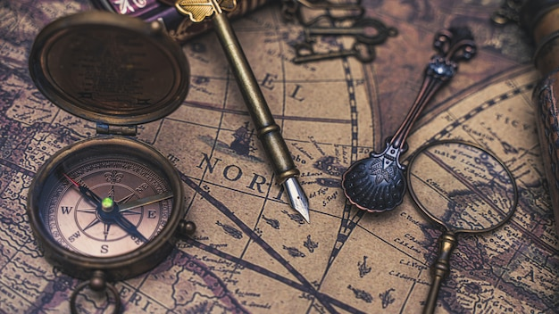 Compass vintage items on map Premium Photo