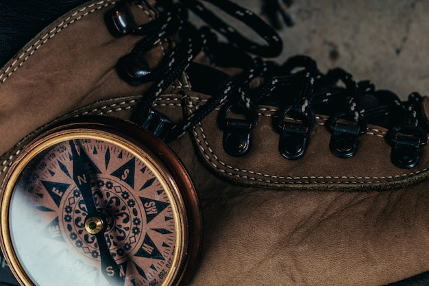 Compass with hiking-boots Premium Photo
