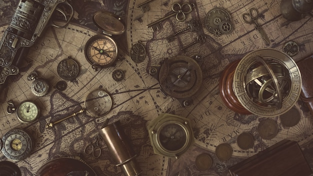 Compass with old collectible on old world map Photo