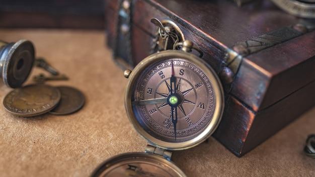 Compass with wooden treasure chest Premium Photo