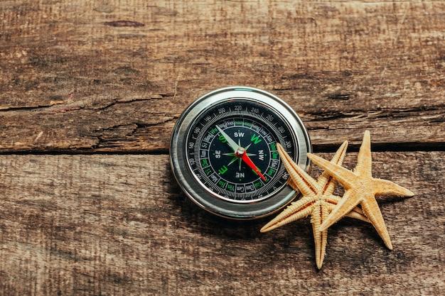 Compass on a wood deck Premium Photo