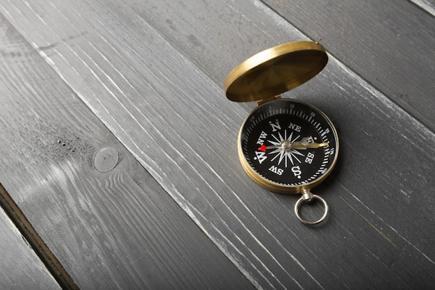 Compass on the wooden table Premium Photo