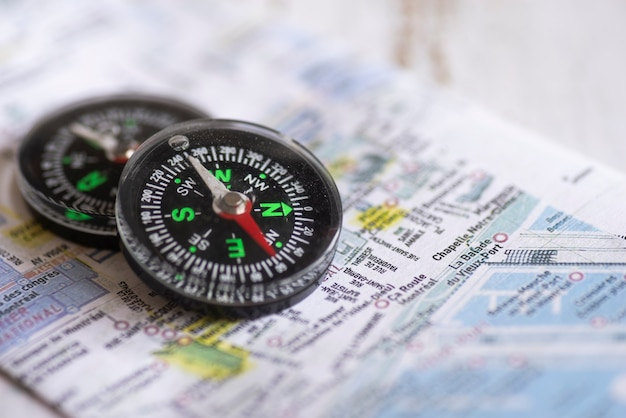 Compasses wtih defocused map Free Photo