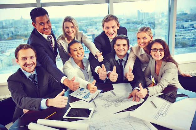 Competent team with thumbs up Free Photo