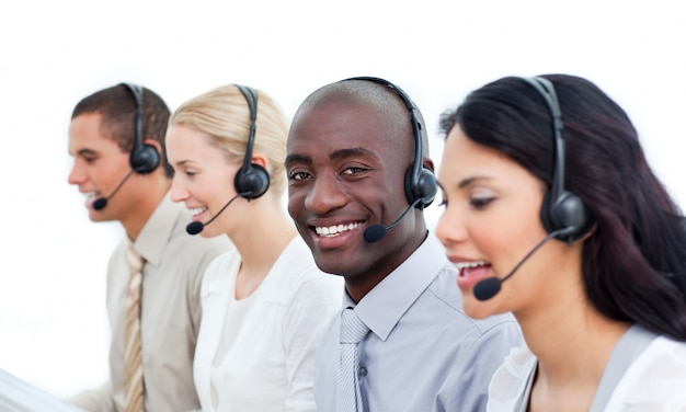Competitive business people working in a call center Premium Photo