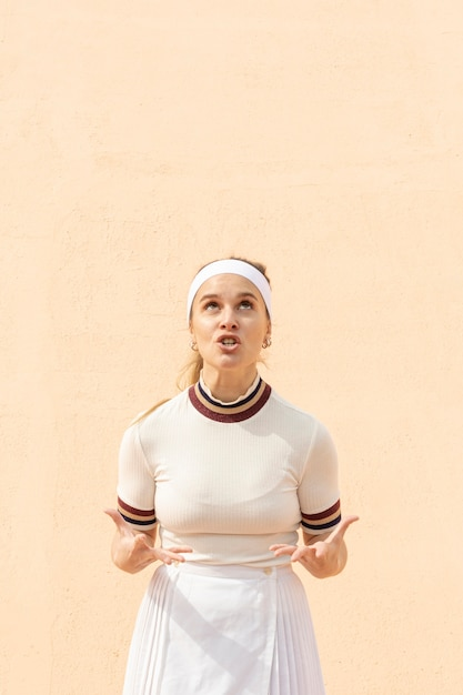 Competitive woman tennis player on field Free Photo