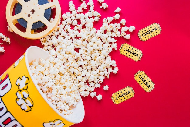 Composed bucket of popcorn and filmstrip Free Photo
