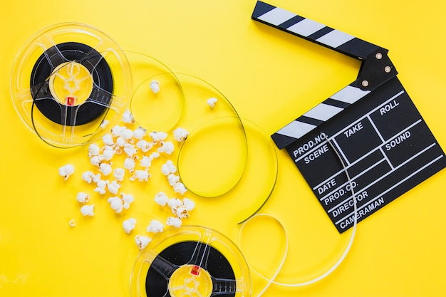 Composed clapboard with reels Free Photo