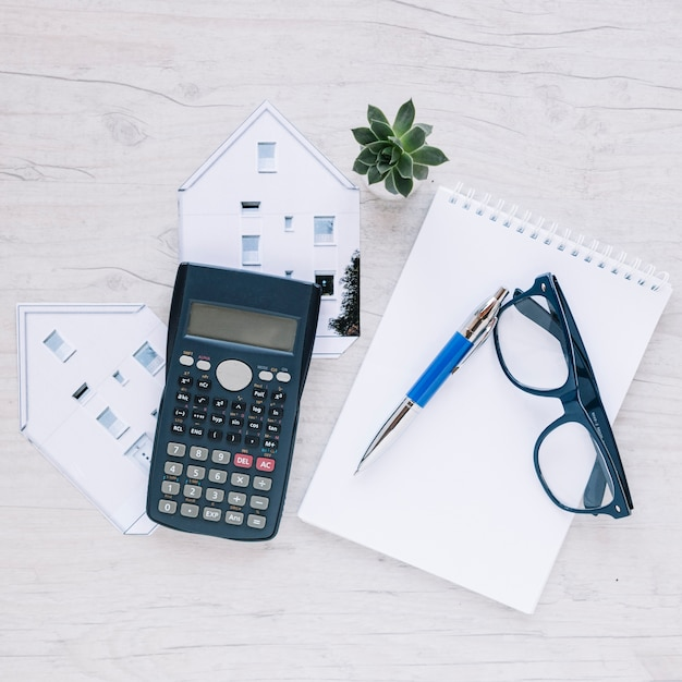 Composed notepad of realtor on desk Free Photo