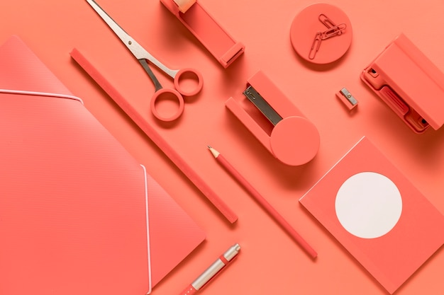 Composition of arranged pink stationery school tools Free Photo